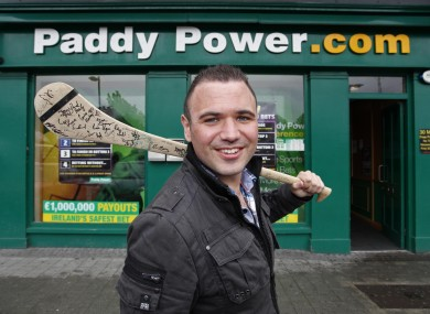 'Jobless Paddy' joins Paddy Power: Féilim Mac An Iomaire poses outside a bookies' outlet earlier today, on his first day working for the company.