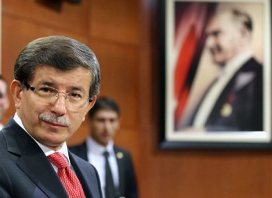 Turkish Foreign Minister Ahmet Davutoglu speaks to the media in Ankara, Turkey.