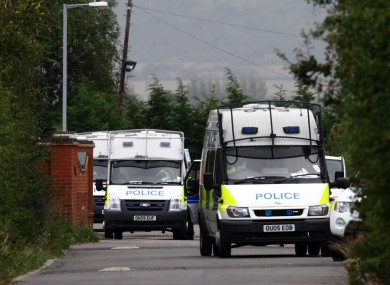 Police vans at the Greenacre caravan site in Leighton