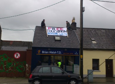 The students have climbed on to the roof of the constituency office.