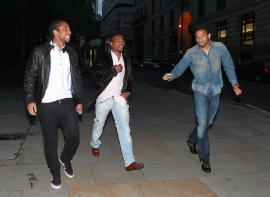Bebe (right) heads out with Anderson and Patrice Evra in Manchester after United captured the league title in May 2011
