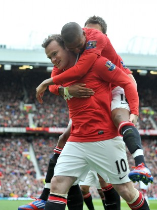 Wayne Rooney celebrates Manchester United's controversial opener