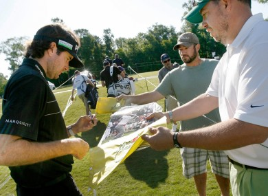 Masters champ Bubba Watson signs autographs for fans yesterday.