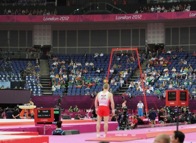 Empty seats are seen during the Artistic Gymnastics team qualification at the North Greenwich Arena, London yesterday