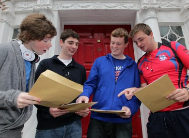 Four Leaving Cert students compare their results - and their overall points score - outside the Catholic University School on Leeson St in Dublin.
