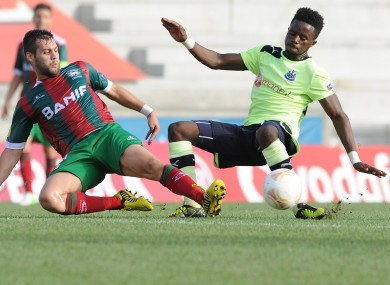 Newcastle United's Gael Bigirimana, right, from Burundi challenges Maritimo's David Simao for the ball during their Europa League Group D soccer match at the Barreiros stadium.