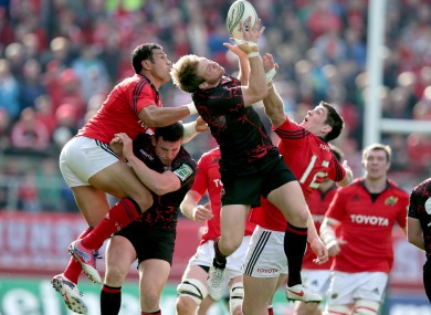 Munster's Casey Laulala and James Downey contest a high ball.