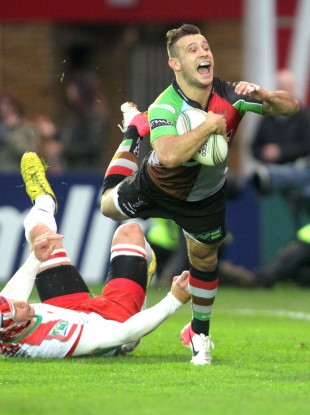 Harlequins' Danny Care dives over ahead of Biarritz's Wenceslas Lauret to score the first try.