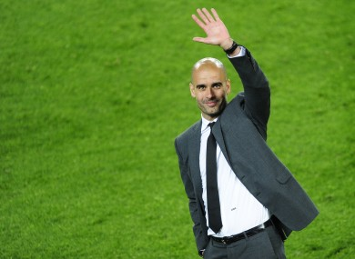 Guardiola waves to Barcelona fans in May.