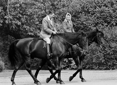 This photo, dated 8 June, 1982, shows US President Ronald Reagan, on Centennial, and Britain's Queen Elizabeth II, on Burmese, horseback riding in the grounds of Windsor Castle, England.