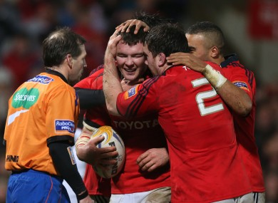 Damien Varley and Simon Zebo congratulate try-scoring Peter O'Mahony.