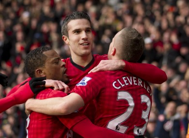 Van Persie is hugged by his team-mates after scoring.