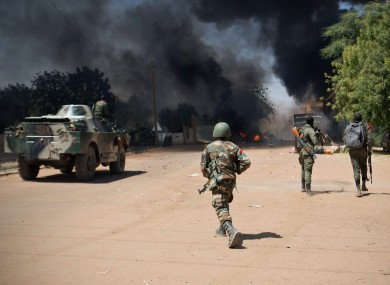 Malian soldiers, working with French forces, battle radical Islamic rebels in Gao, Mali yesterday.