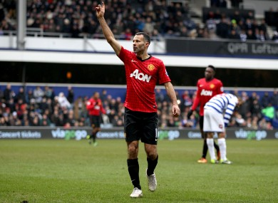Ryan Giggs salutes fans after scoring.