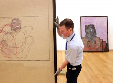 Hugh Lane Gallery attendant Peader Fitzgerald packs up Francis Bacon paintings being moved to Brussels.