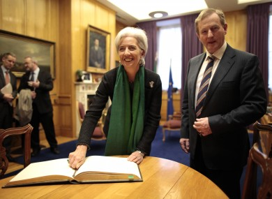 IMF managing director Christine Lagarde signs the guest book in the Taoiseach's Office.