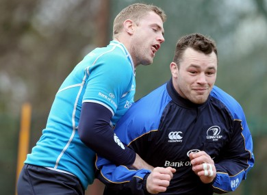 Jamie Heaslip and Cian Healy jostle in training.