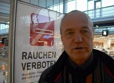 Dietmar Erlacher reporting from a large shopping centre where he films smoker flouting a smoking ban.