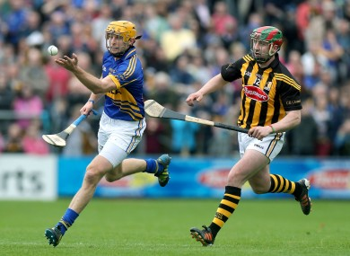 Kilkenny's Eoin Larkin and Shane McGrath of Tipperary.