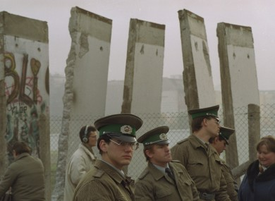East German border guards in front of segments of the Berlin Wall towards the end of the Cold War