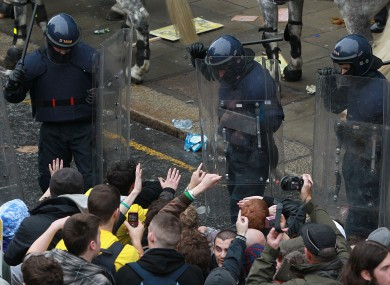 Students and gardaí in riot gear at the protest in November 2010.