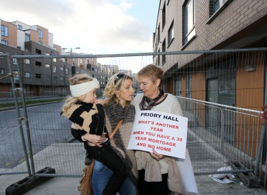 Sinead, Isable (5) and Maxie Power standing their former home at a march last year