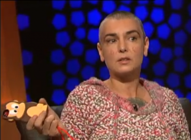 Sinéad O'Connor and her monkey-encased iPhone.