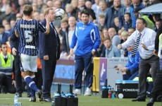 Harry Redknapp gets a ball in the face, gives Millwall official an ear-bashing