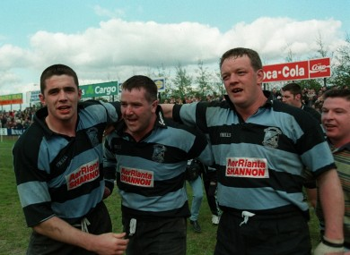 Alan Quinlan, Anthony Foley and Mick Galwey celebrate a playoff victory in 1998.