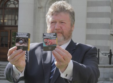 Health Minister James Reilly with a sample of the packaging (File photo)