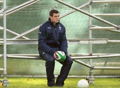 Jonny Sexton observes Ireland's training, on Tuesday, from a scaffold.