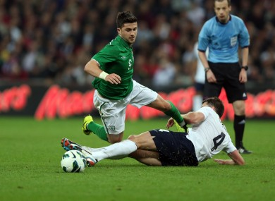 Shane Long in action for Ireland against England.