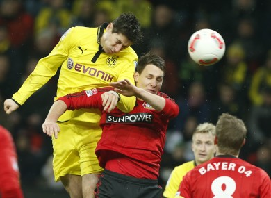 Robert Lewandowski and Leverkusen's Philipp Wollscheid last season.