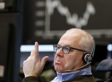 A trader makes a telephone call at the stock market in Frankfurt, Germany.