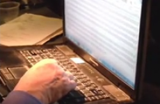 Guy amusingly falls asleep with his finger on the slash key