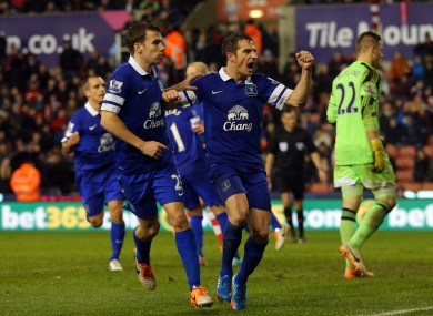 Leighton Baines celebrates his 90th minute penalty.