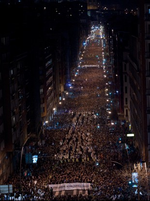 Pro-independence Basque demonstrators gather on the street during a protest in Bilbao.