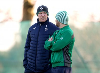 Paul O'Connell and Rob Kearney watch training this morning.