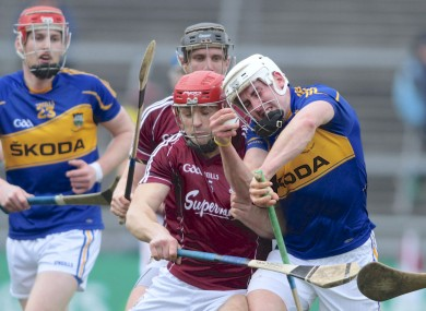 Galway's Iarla Tannian clashes with Tipperary's Padraic Maher.