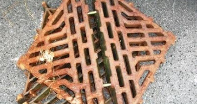 Two arrested for theft of 15 manhole covers